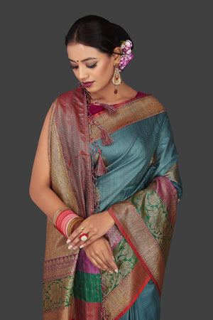 Buy gorgeous steel blue tassar Banarasi saree online in USA with antique zari border and zari buta. Garner compliments on weddings and special occasions with exquisite Banarasi sarees, handwoven silk sarees, tussar sarees from Pure Elegance Indian fashion store in USA.-closeup