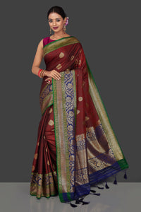Shop rich maroon tassar Banarasi sari online in USA with antique zari blue pallu. Garner compliments on weddings and special occasions with exquisite Banarasi sarees, handwoven silk sarees, tussar sarees from Pure Elegance Indian fashion store in USA.-full view