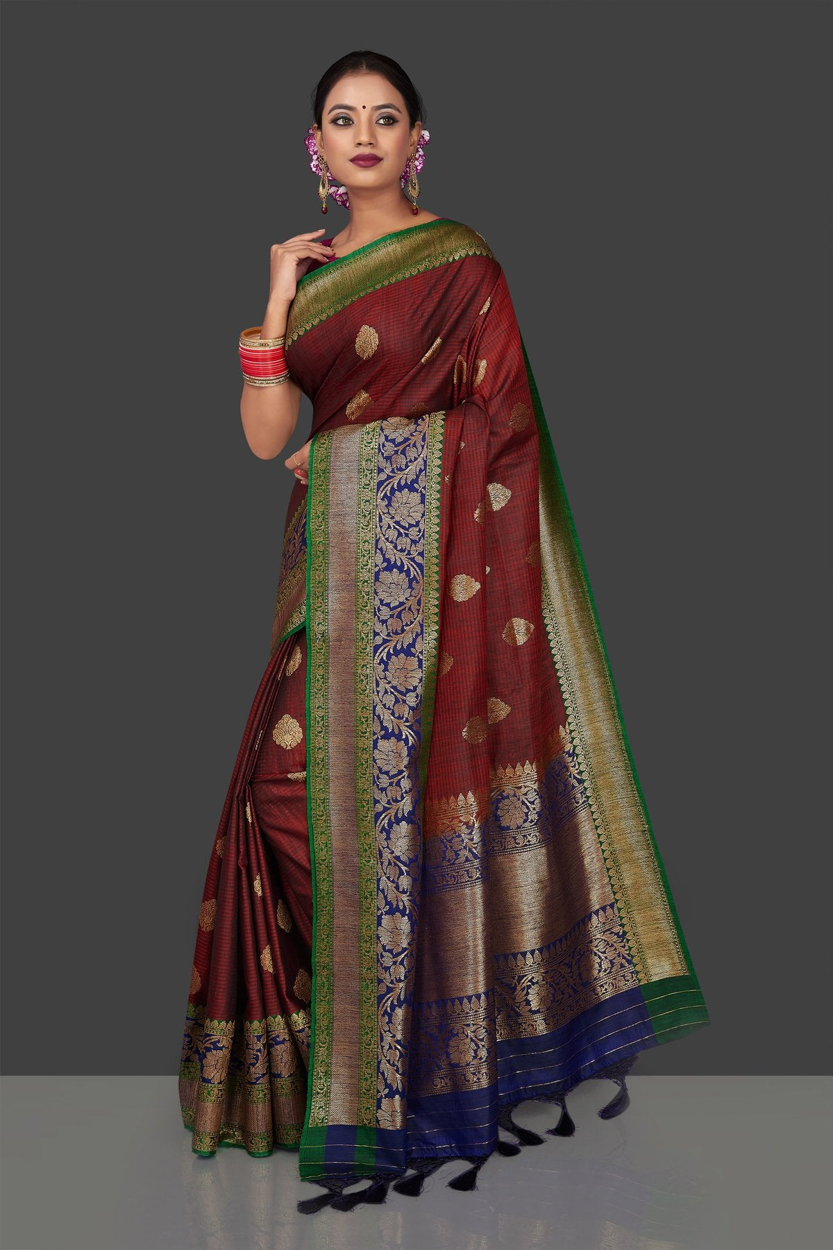 Shop rich maroon tassar Banarasi sari online in USA with antique zari blue pallu. Garner compliments on weddings and special occasions with exquisite Banarasi sarees, handwoven silk sarees, tussar sarees from Pure Elegance Indian fashion store in USA.-front
