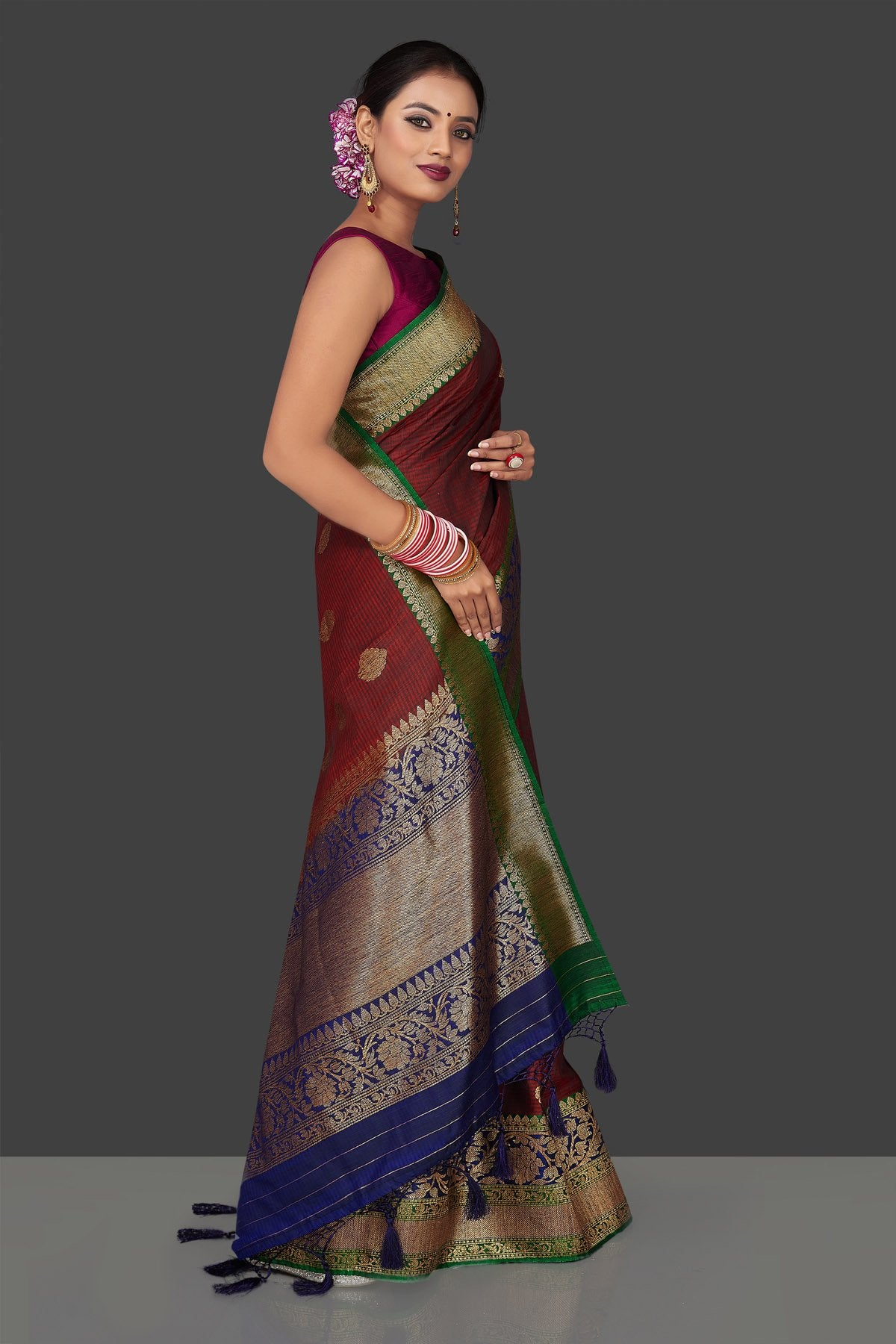 Shop rich maroon tassar Banarasi sari online in USA with antique zari blue pallu. Garner compliments on weddings and special occasions with exquisite Banarasi sarees, handwoven silk sarees, tussar sarees from Pure Elegance Indian fashion store in USA.-right