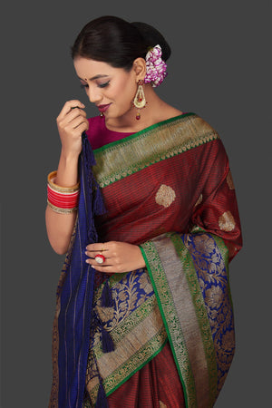 Shop rich maroon tassar Banarasi sari online in USA with antique zari blue pallu. Garner compliments on weddings and special occasions with exquisite Banarasi sarees, handwoven silk sarees, tussar sarees from Pure Elegance Indian fashion store in USA.-closeup