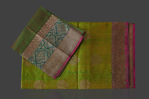 Buy lovely yellowish green tassar Banarasi saree online in USA with antique zari pallu. Garner compliments on weddings and special occasions with exquisite Banarasi sarees, handwoven silk sarees, tussar sarees from Pure Elegance Indian fashion store in USA.-details