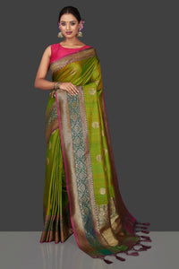 Buy lovely yellowish green tassar Banarasi saree online in USA with antique zari pallu. Garner compliments on weddings and special occasions with exquisite Banarasi sarees, handwoven silk sarees, tussar sarees from Pure Elegance Indian fashion store in USA.-full view
