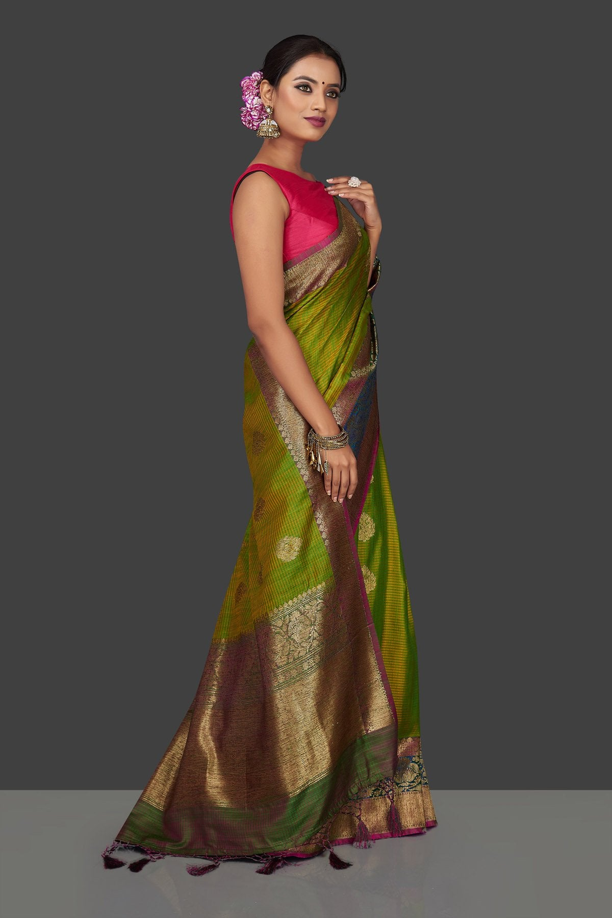 Buy lovely yellowish green tassar Banarasi saree online in USA with antique zari pallu. Garner compliments on weddings and special occasions with exquisite Banarasi sarees, handwoven silk sarees, tussar sarees from Pure Elegance Indian fashion store in USA.-right