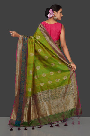 Buy lovely yellowish green tassar Banarasi saree online in USA with antique zari pallu. Garner compliments on weddings and special occasions with exquisite Banarasi sarees, handwoven silk sarees, tussar sarees from Pure Elegance Indian fashion store in USA.-back