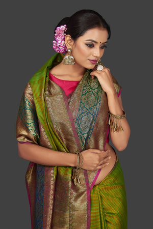 Buy lovely yellowish green tassar Banarasi saree online in USA with antique zari pallu. Garner compliments on weddings and special occasions with exquisite Banarasi sarees, handwoven silk sarees, tussar sarees from Pure Elegance Indian fashion store in USA.-closeup