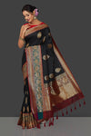 Buy ravishing black tassar Banarasi saree online in USA with antique zari red and green border. Garner compliments on weddings and special occasions with exquisite Banarasi sarees, handwoven silk sarees, tussar sarees from Pure Elegance Indian fashion store in USA.-full view
