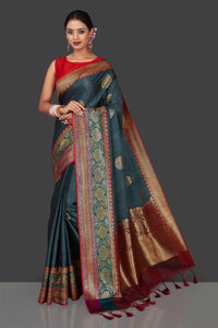 Buy beautiful steel blue striped tassar Banarasi sari online in USA with antique zari border. Garner compliments on weddings and special occasions with exquisite Banarasi sarees, handwoven silk sarees, tussar sarees from Pure Elegance Indian fashion store in USA.-full view