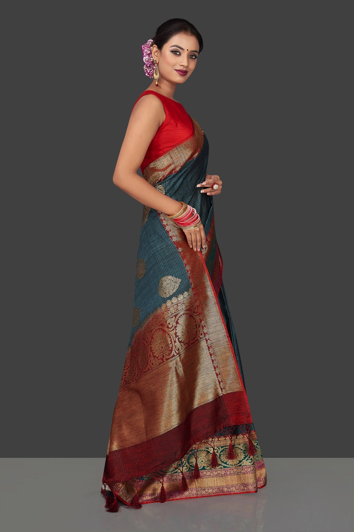 Buy beautiful steel blue striped tassar Banarasi sari online in USA with antique zari border. Garner compliments on weddings and special occasions with exquisite Banarasi sarees, handwoven silk sarees, tussar sarees from Pure Elegance Indian fashion store in USA.-right