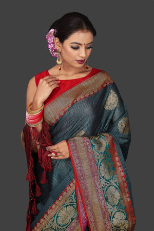 Buy beautiful steel blue striped tassar Banarasi sari online in USA with antique zari border. Garner compliments on weddings and special occasions with exquisite Banarasi sarees, handwoven silk sarees, tussar sarees from Pure Elegance Indian fashion store in USA.-closeup
