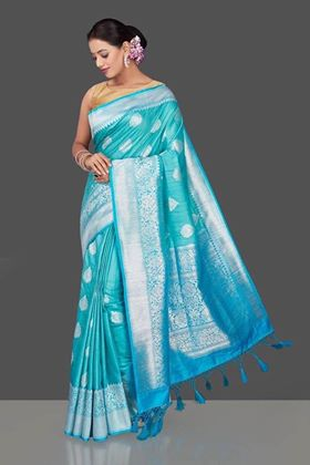 Buy lovely light blue tussar Banarasi saree online in USA with silver zari border. Garner compliments on weddings and special occasions with exquisite Banarasi sarees, handwoven silk saris, tussar sarees from Pure Elegance Indian fashion store in USA.-full view