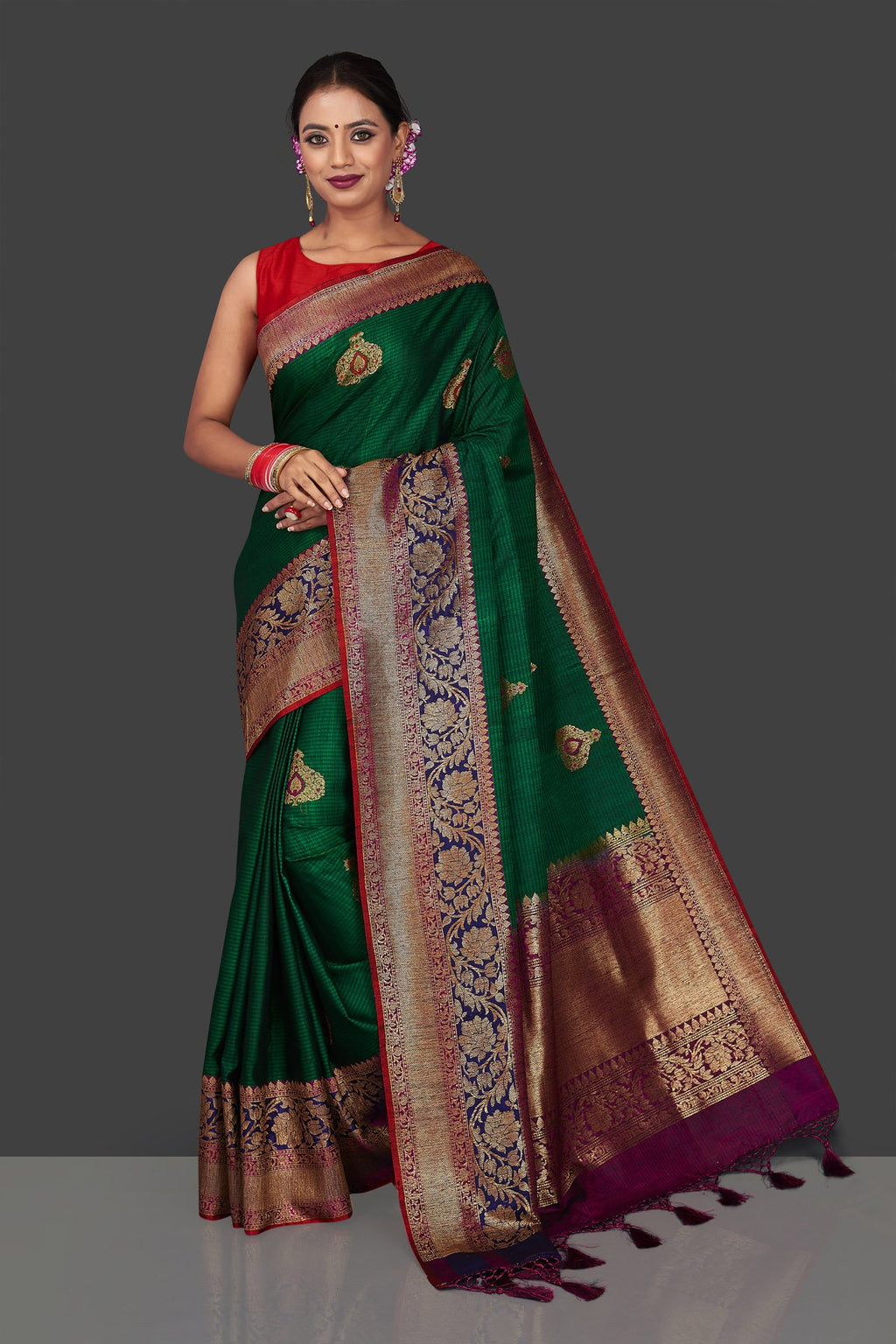 Buy stunning dark green tussar Banarasi saree online in USA with heavy zari buta. Garner compliments on weddings and special occasions with exquisite Banarasi sarees, handwoven silk saris, tussar sarees from Pure Elegance Indian fashion store in USA.-full view