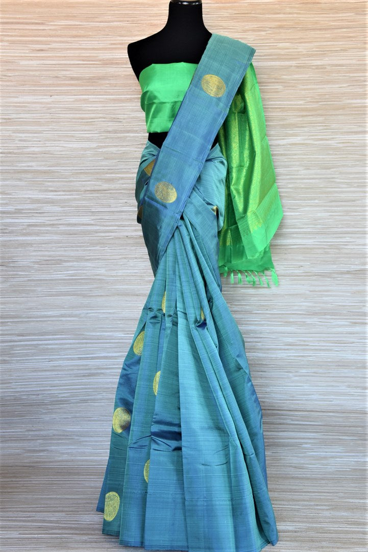 Shop attractive light blue borderless Kanjivaram saree online in USA with golden zari green pallu. Keep it traditional on weddings and special occasions with beautiful silk saris, Kanjivaram sarees from Pure Elegance Indian fashion store in USA.-full view