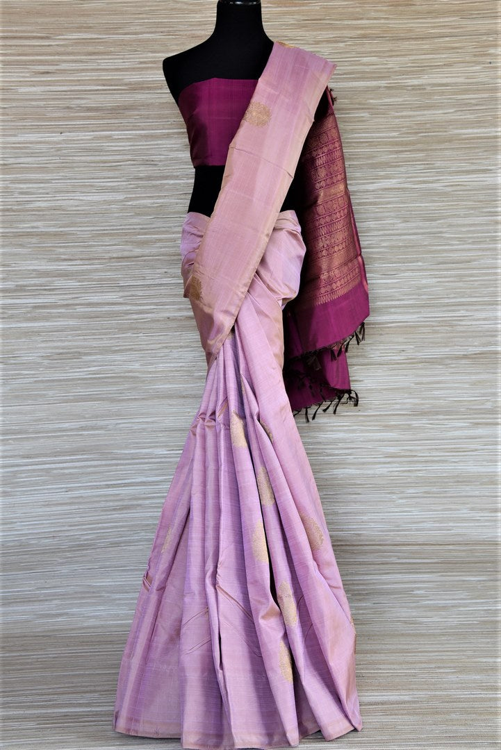 Buy stunning lilac color borderless Kanjivaram sari online in USA with golden zari purple pallu. Keep it traditional on weddings and special occasions with beautiful silk saris, Kanjivaram sarees from Pure Elegance Indian fashion store in USA.-full view