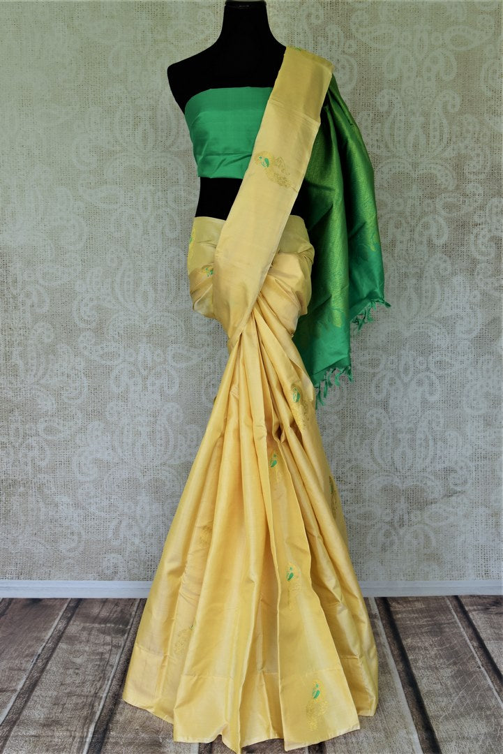 Buy beautiful lemon yellow Kanjivaram sari online in USA with peacock zari buta and green zari pallu. Shop beautiful Kanchipuram silk sarees, pure zari silk sarees in USA from Pure Elegance Indian fashion store in USA. Shop online now.-full view