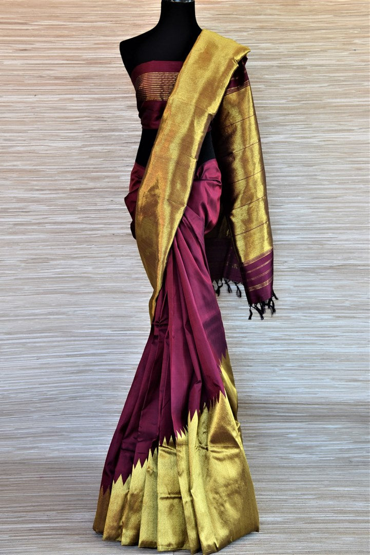 Shop beautiful wine color Kanjivaram silk sari online in USA with golden zari temple border. Keep it traditional on weddings and special occasions with beautiful silk sarees, Kanchipuram silk sarees from Pure Elegance Indian fashion store in USA.-full view