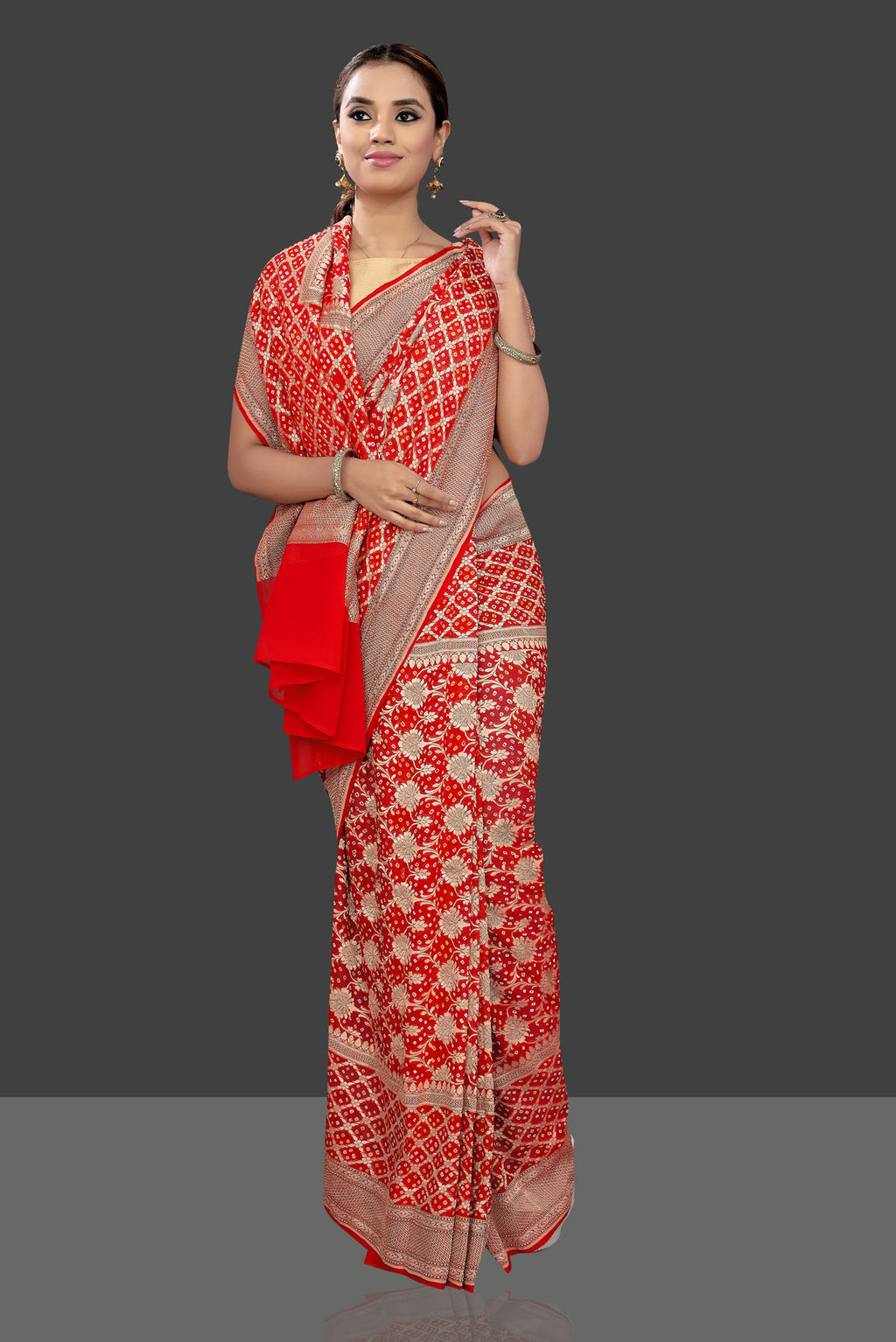 Shop red georgette Banarasi Bandhej saree online in USA with zari work. Stand out at weddings and festive occasions with your tasteful choice in this gorgeous Banarasi sarees, georgette sarees, handloom sarees, embroidered saris from Pure Elegance Indian fashion store in USA.-full view
