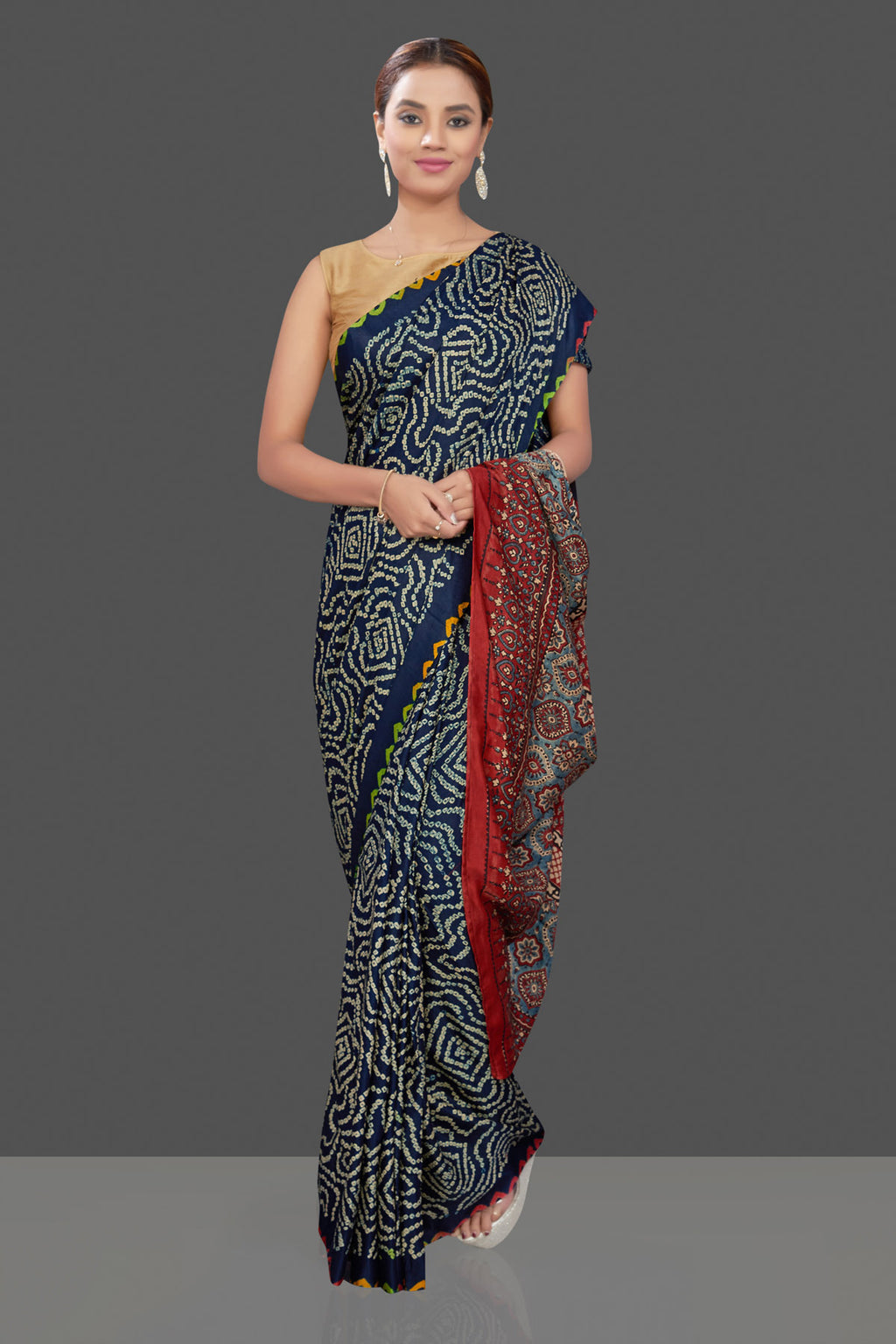 Shop dark blue Bandhej gajji silk saree online in USA with Ajrakh pallu. Stand out at weddings and festive occasions with your tasteful choice in this gorgeous pure silk saris,  printed sarees, Bandhej saris, handwoven sarees from Pure Elegance Indian fashion store in USA. -full view