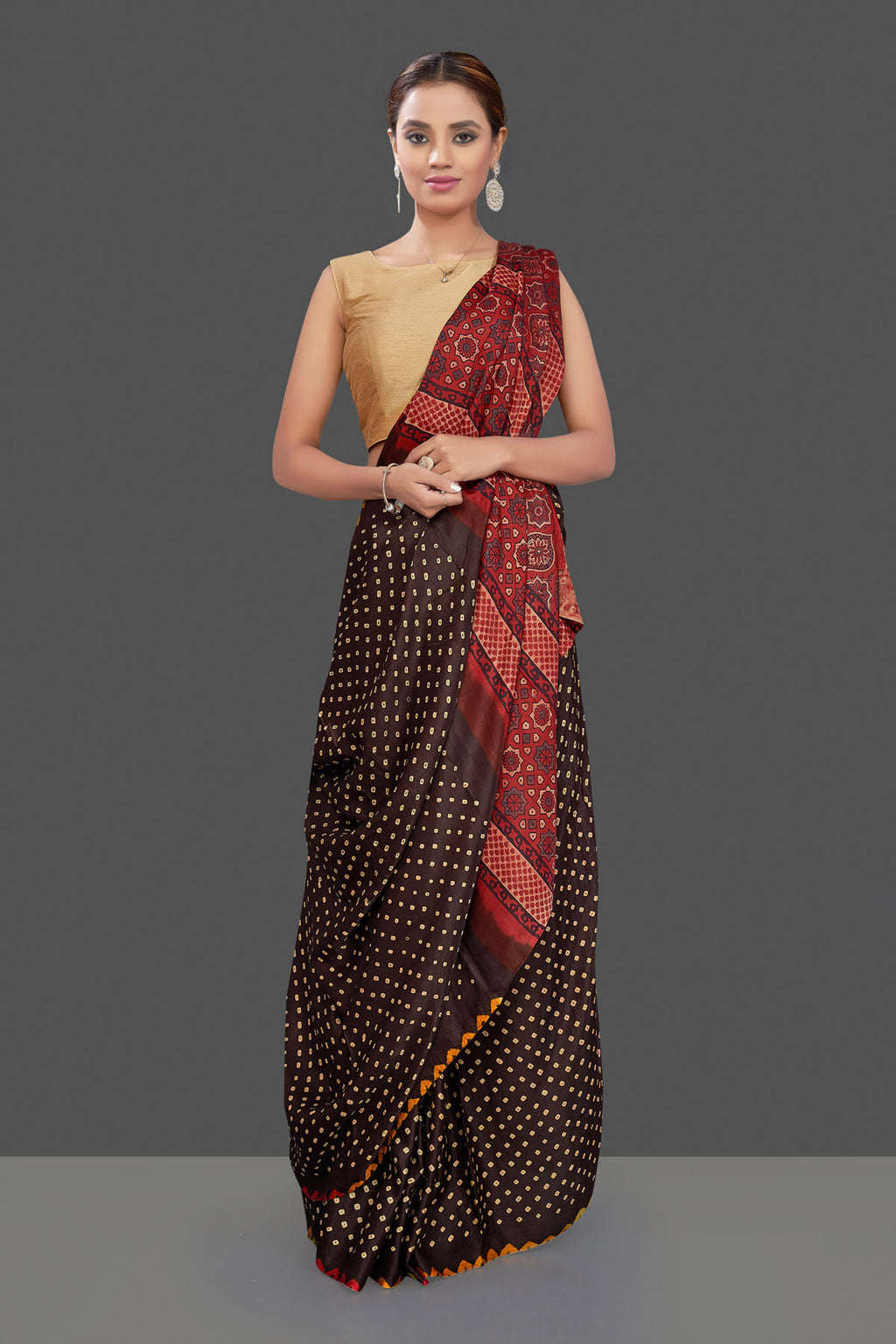 Buy gorgeous dark brown gajji silk Bandhej saree online in USA with Ajrakh pallu. Stand out at weddings and festive occasions with your tasteful choice in this gorgeous pure silk saris,  printed sarees, Bandhej saris, handwoven sarees from Pure Elegance Indian fashion store in USA. -full view