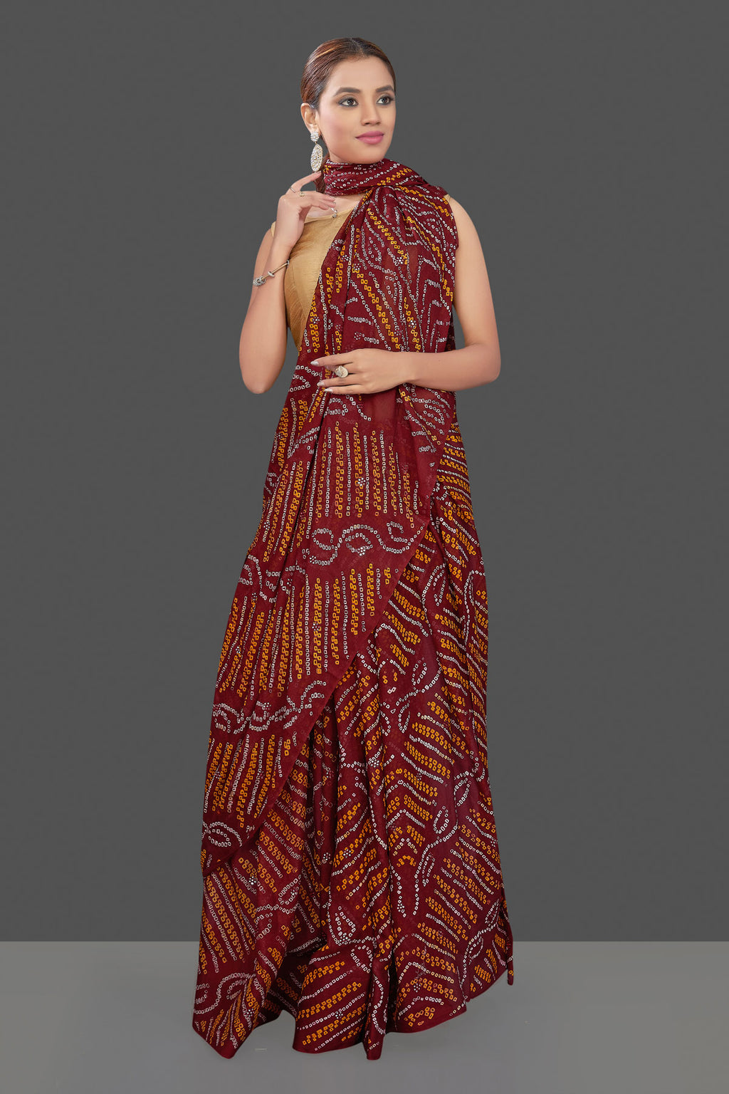 Shop elegant maroon Bandhej print chiffon saree online in USA. Stand out at weddings and festive occasions with your tasteful choice in this gorgeous chiffon saris,  printed sarees, Bandhej saris, handwoven sarees from Pure Elegance Indian fashion store in USA. -full view