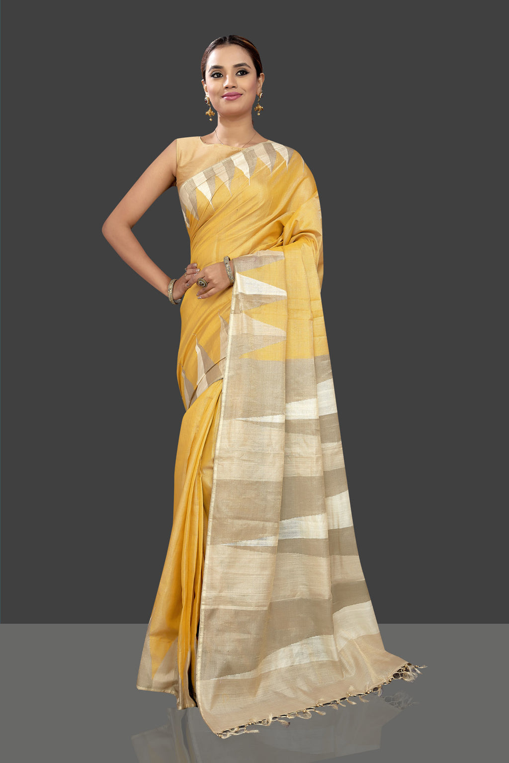 Shop charming bright yellow tissue tussar sari online in USA with beige temple border. Shop stunning designer sarees, handwoven sarees, embroidered sarees, printed sarees, pure silk sarees in latest designs from Pure Elegance Indian fashion boutique in USA.-full view
