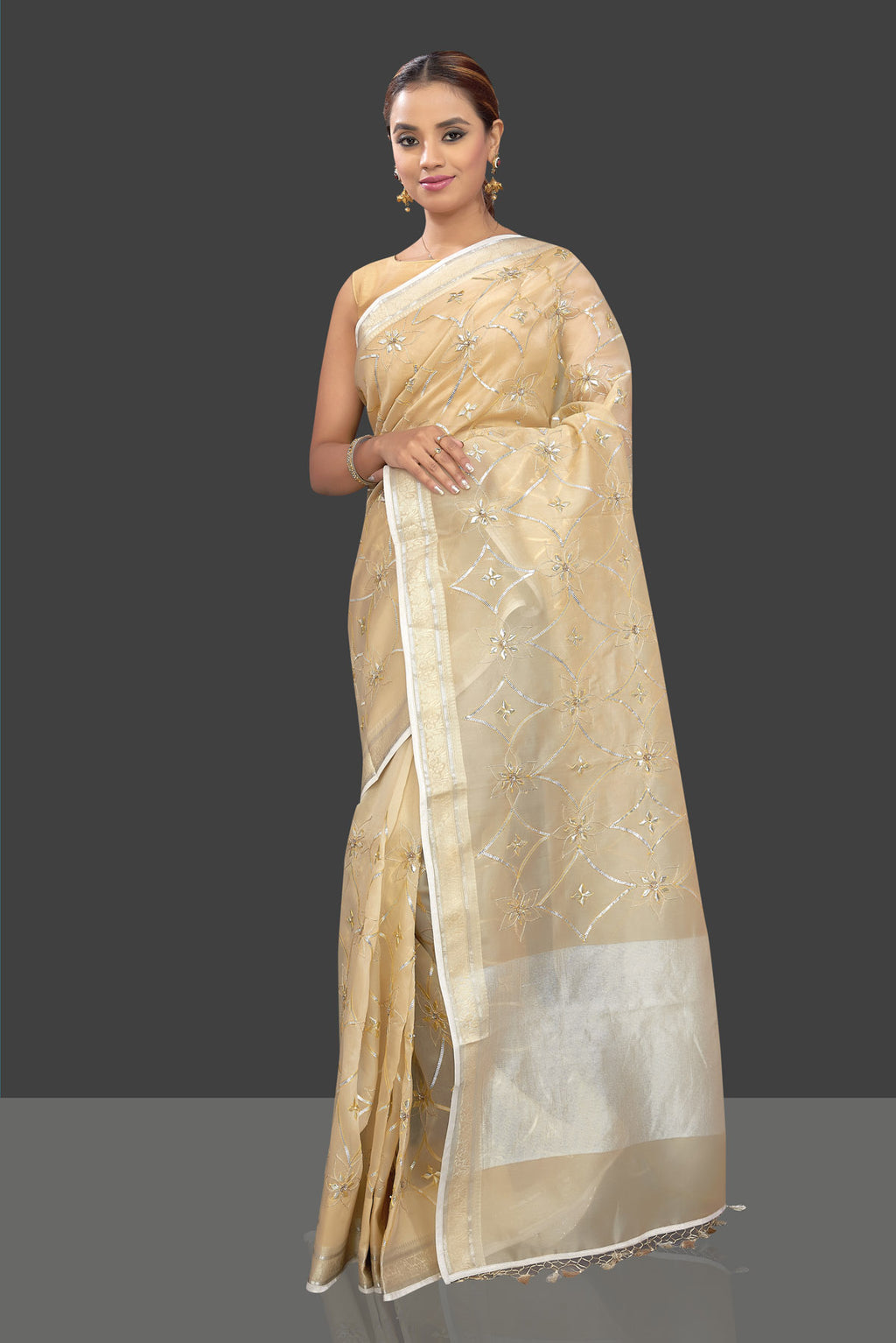Buy beautiful cream organza saree online in USA with gota patti embroidery. Shop stunning designer sarees, handwoven sarees, embroidered sarees, printed sarees, pure silk sarees in latest designs from Pure Elegance Indian fashion boutique in USA.-front