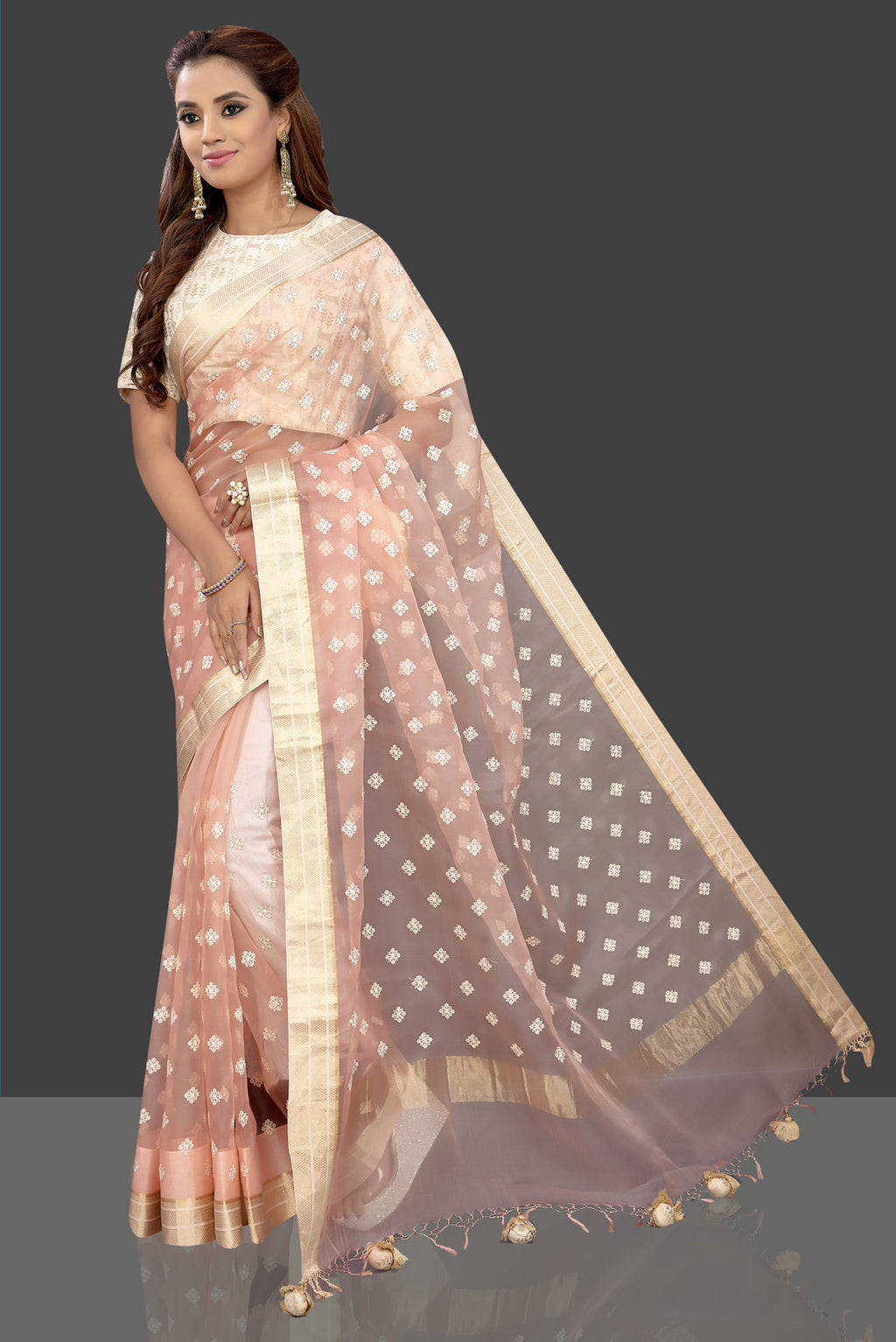 Shop beautiful peach embroidered chanderi saree online in USA with cream saree blouse. Shop stunning designer sarees, handwoven sarees, embroidered sarees, printed sarees, pure silk sarees in latest designs from Pure Elegance Indian fashion boutique in USA.-full view