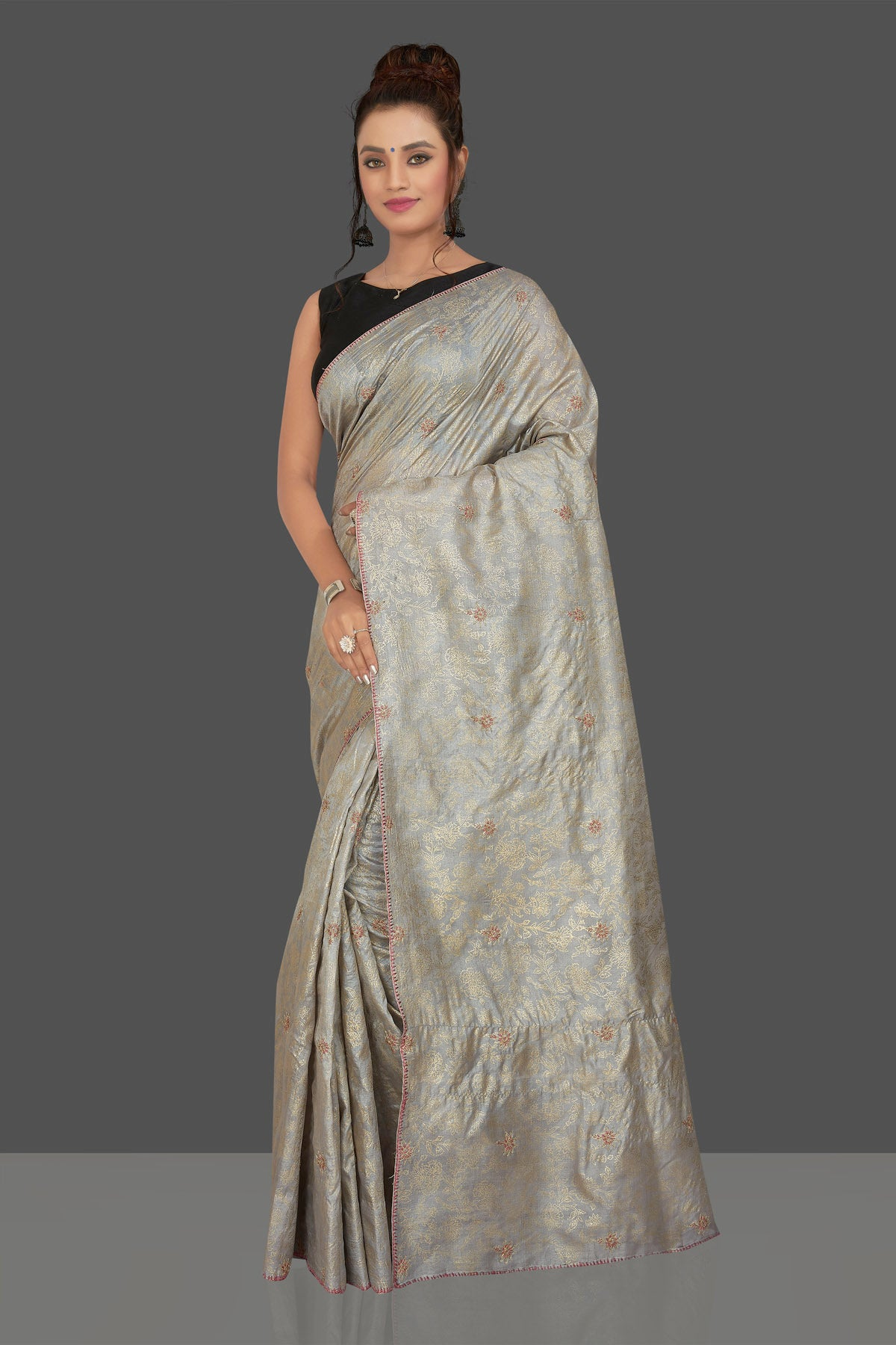 Buy gorgeous light grey embroidered tussar sari online in USA with floral zari work. Shop beautiful tussar sarees, hand embroidered saris, georgette sarees, designer sarees in USA from Pure Elegance Indian fashion store in USA. Shop online now.-full view