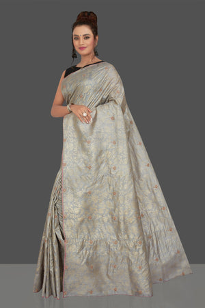 Buy gorgeous light grey embroidered tussar sari online in USA with floral zari work. Shop beautiful tussar sarees, hand embroidered saris, georgette sarees, designer sarees in USA from Pure Elegance Indian fashion store in USA. Shop online now.-pallu