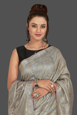 Buy gorgeous light grey embroidered tussar sari online in USA with floral zari work. Shop beautiful tussar sarees, hand embroidered saris, georgette sarees, designer sarees in USA from Pure Elegance Indian fashion store in USA. Shop online now.-closeup