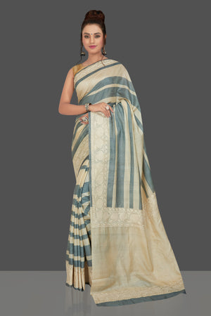 Buy elegant cream and grey stripes embroidered tussar silk saree online in USA. Shop for weddings and special occasions stunning tussar sarees, hand embroidered saris, georgette sarees, designer sarees in USA from Pure Elegance Indian clothing store in USA. Shop online now.-front