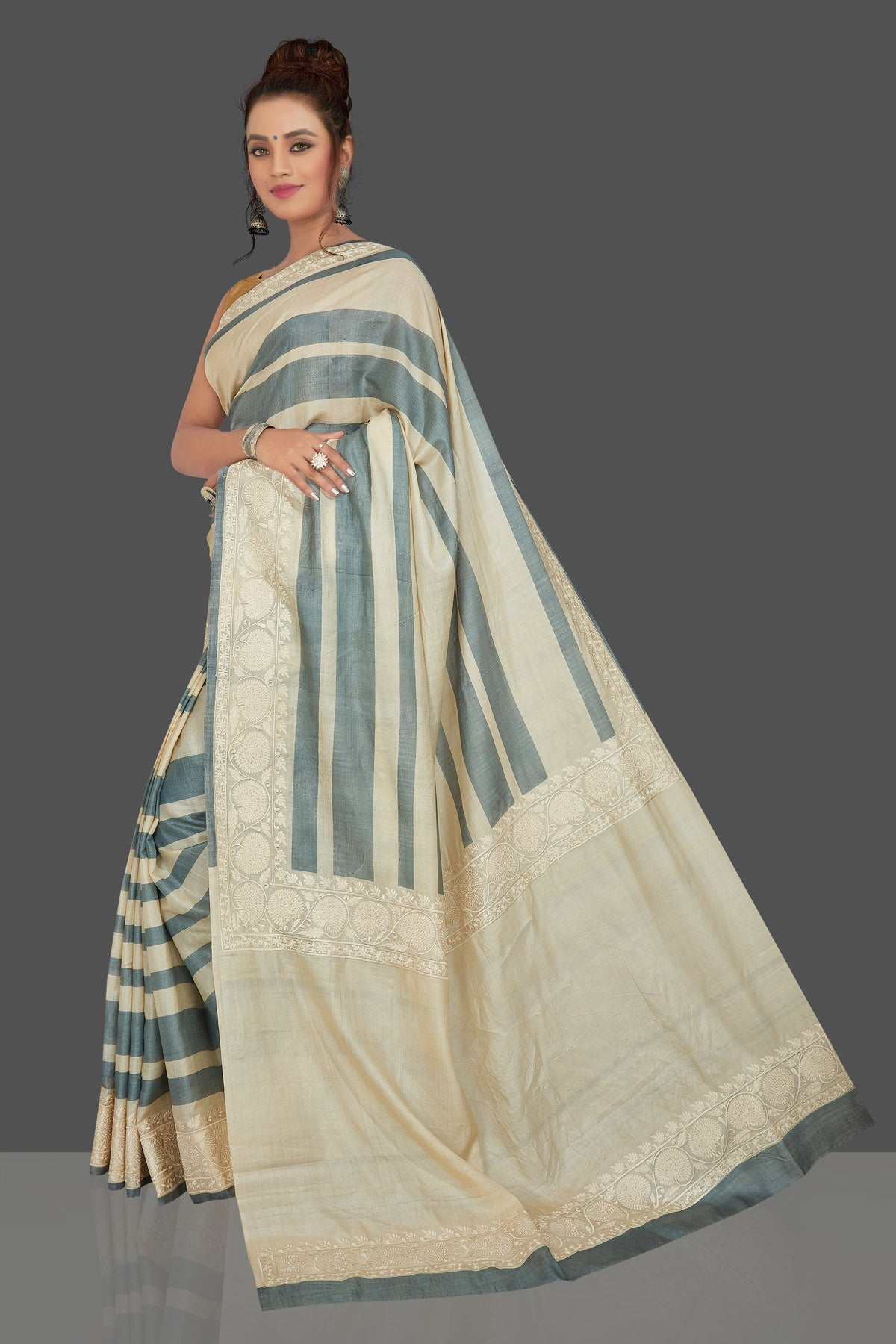 Buy elegant cream and grey stripes embroidered tussar silk saree online in USA. Shop for weddings and special occasions stunning tussar sarees, hand embroidered saris, georgette sarees, designer sarees in USA from Pure Elegance Indian clothing store in USA. Shop online now.-full view