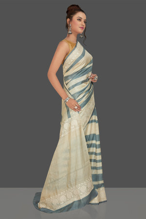 Buy elegant cream and grey stripes embroidered tussar silk saree online in USA. Shop for weddings and special occasions stunning tussar sarees, hand embroidered saris, georgette sarees, designer sarees in USA from Pure Elegance Indian clothing store in USA. Shop online now.-side