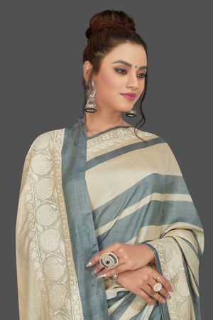 Buy elegant cream and grey stripes embroidered tussar silk saree online in USA. Shop for weddings and special occasions stunning tussar sarees, hand embroidered saris, georgette sarees, designer sarees in USA from Pure Elegance Indian clothing store in USA. Shop online now.-closeup
