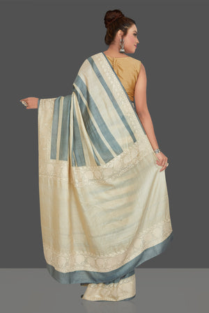 Buy elegant cream and grey stripes embroidered tussar silk saree online in USA. Shop for weddings and special occasions stunning tussar sarees, hand embroidered saris, georgette sarees, designer sarees in USA from Pure Elegance Indian clothing store in USA. Shop online now.-back
