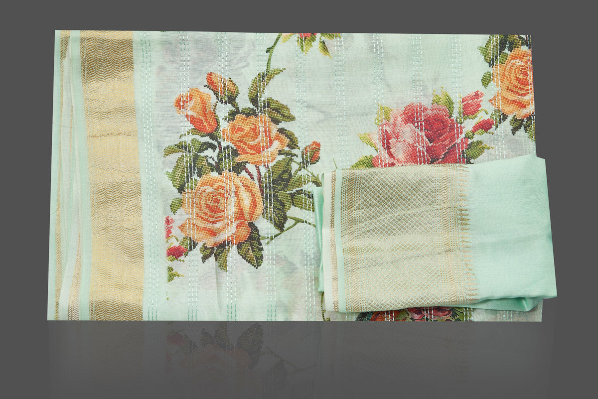 Buy beautiful mint green floral print muga silk saree online in USA with golden zari border. Make you presence felt with your Indian style on special occasions in beautiful designer sarees, handwoven sarees, tussar sarees, muga silk sarees from Pure Elegance Indian fashion store in USA.-blouse