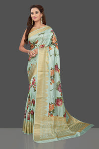 Buy beautiful mint green floral print muga silk saree online in USA with golden zari border. Make you presence felt with your Indian style on special occasions in beautiful designer sarees, handwoven sarees, tussar sarees, muga silk sarees from Pure Elegance Indian fashion store in USA.-full view