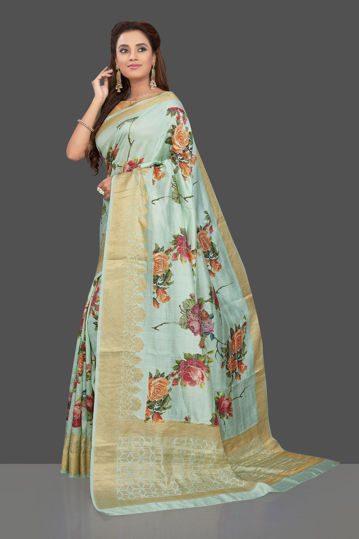Buy beautiful mint green floral print muga silk saree online in USA with golden zari border. Make you presence felt with your Indian style on special occasions in beautiful designer sarees, handwoven sarees, tussar sarees, muga silk sarees from Pure Elegance Indian fashion store in USA.-pallu