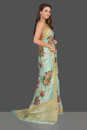 Buy beautiful mint green floral print muga silk saree online in USA with golden zari border. Make you presence felt with your Indian style on special occasions in beautiful designer sarees, handwoven sarees, tussar sarees, muga silk sarees from Pure Elegance Indian fashion store in USA.-side