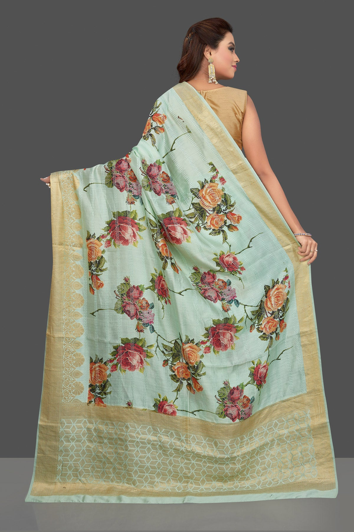 Buy beautiful mint green floral print muga silk saree online in USA with golden zari border. Make you presence felt with your Indian style on special occasions in beautiful designer sarees, handwoven sarees, tussar sarees, muga silk sarees from Pure Elegance Indian fashion store in USA.-back