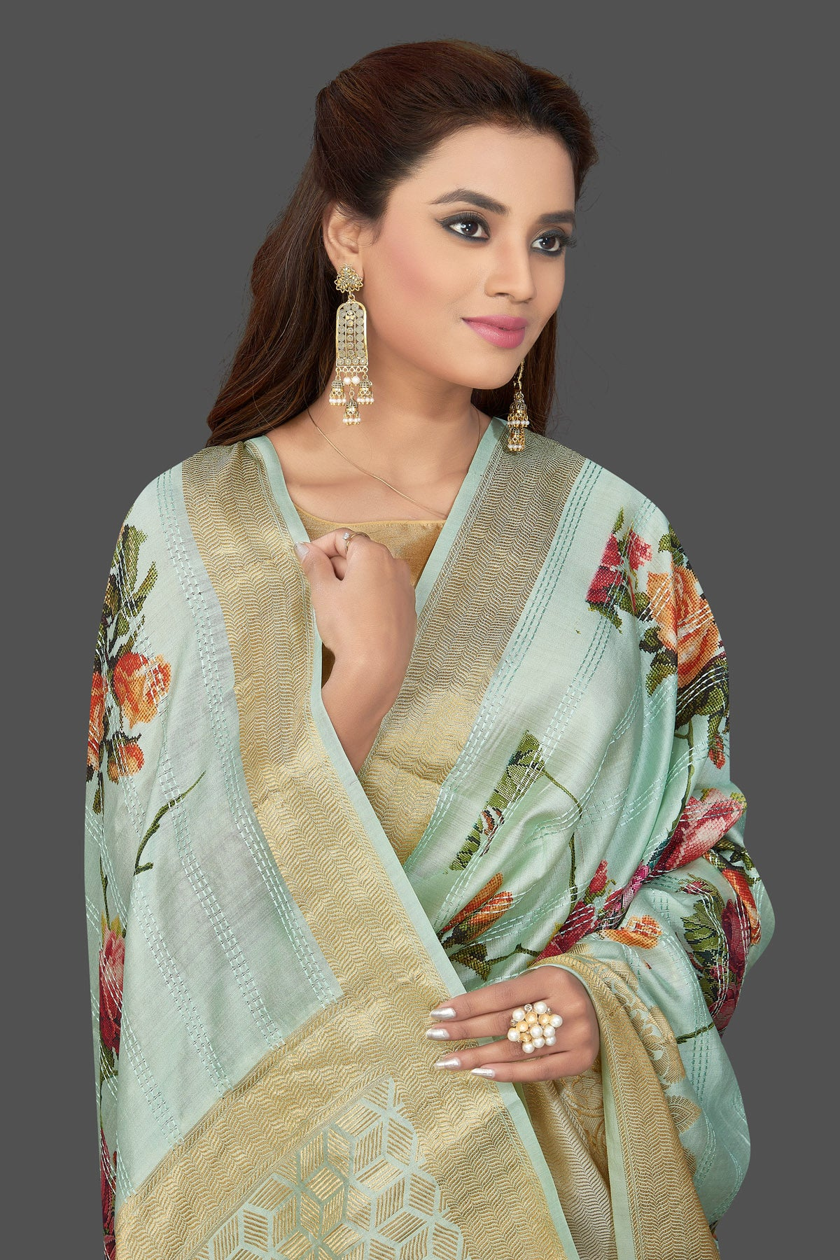 Buy beautiful mint green floral print muga silk saree online in USA with golden zari border. Make you presence felt with your Indian style on special occasions in beautiful designer sarees, handwoven sarees, tussar sarees, muga silk sarees from Pure Elegance Indian fashion store in USA.-closeup