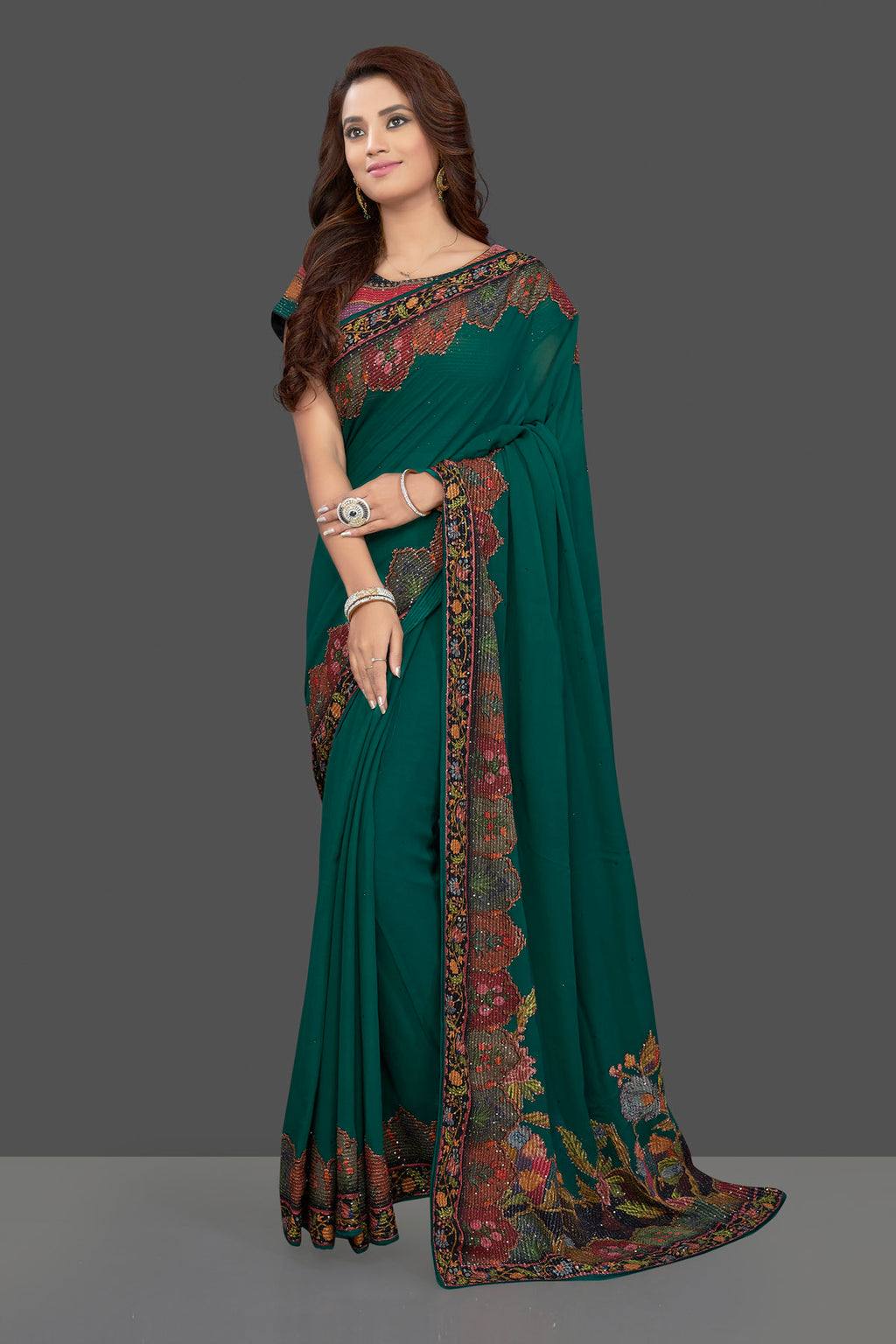 Buy beautiful dark green georgette saree online in USA with multicolor printed border. Make you presence felt with your Indian style on special occasions in beautiful designer sarees, handwoven sarees, muga sarees, georgette sarees from Pure Elegance Indian fashion store in USA.-full view