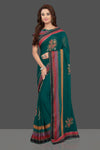 Buy attractive dark green georgette saree online in USA with multicolor border and saree blouse. Make you presence felt with your Indian style on special occasions in beautiful designer sarees, handwoven sarees, muga sarees, georgette sarees from Pure Elegance Indian fashion store in USA.-full view