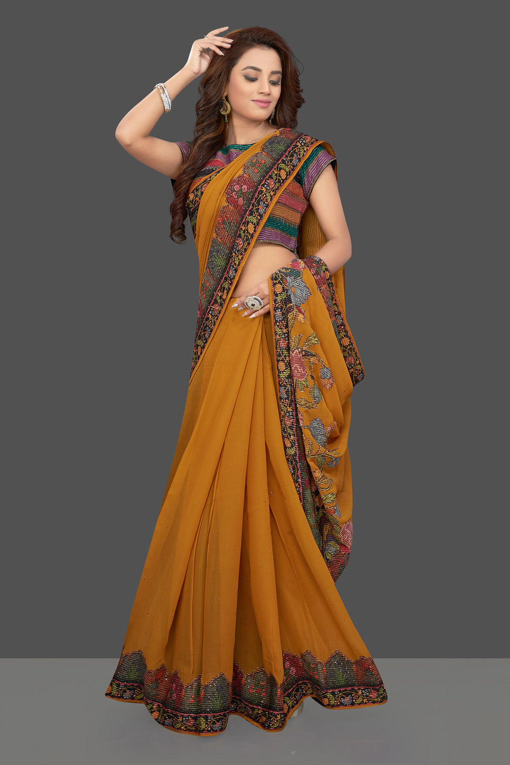 Buy stunning mustard color georgette saree online in USA with multicolor border and sari blouse. Make you presence felt with your Indian style on special occasions in beautiful designer sarees, handwoven sarees, muga sarees, georgette sarees from Pure Elegance Indian fashion store in USA.-full view