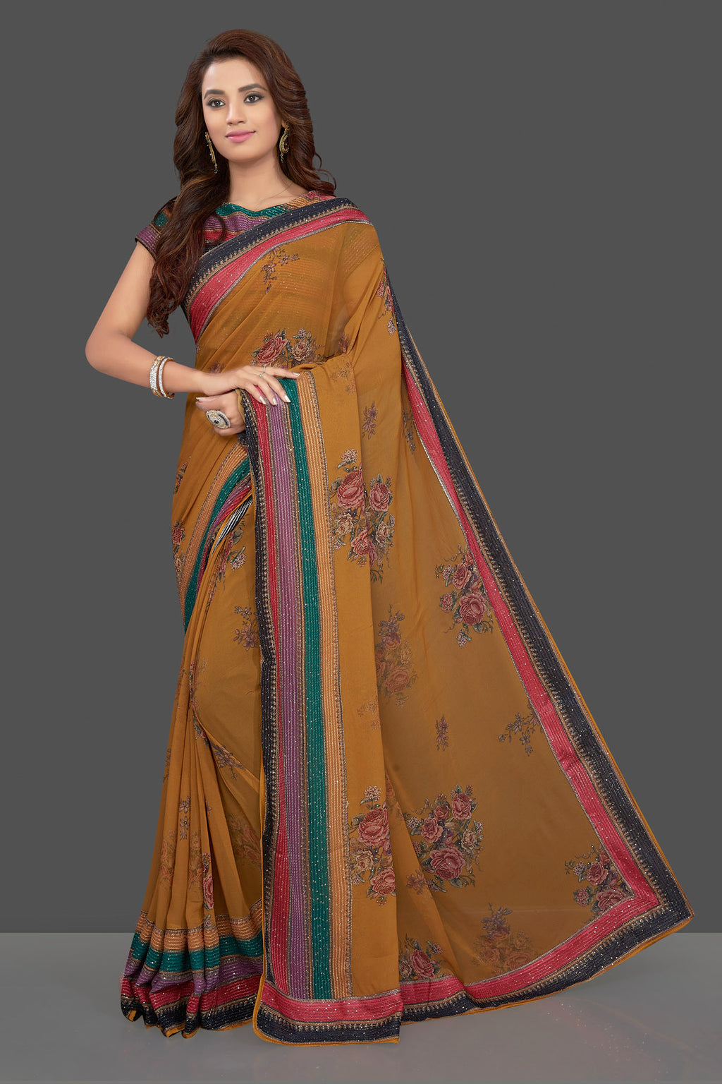 Shop beautiful mustard floral georgette saree online in USA with multicolor blouse. Make you presence felt with your Indian style on special occasions in beautiful designer sarees, embroidered sarees, muga sarees, georgette sarees from Pure Elegance Indian fashion store in USA.-full view