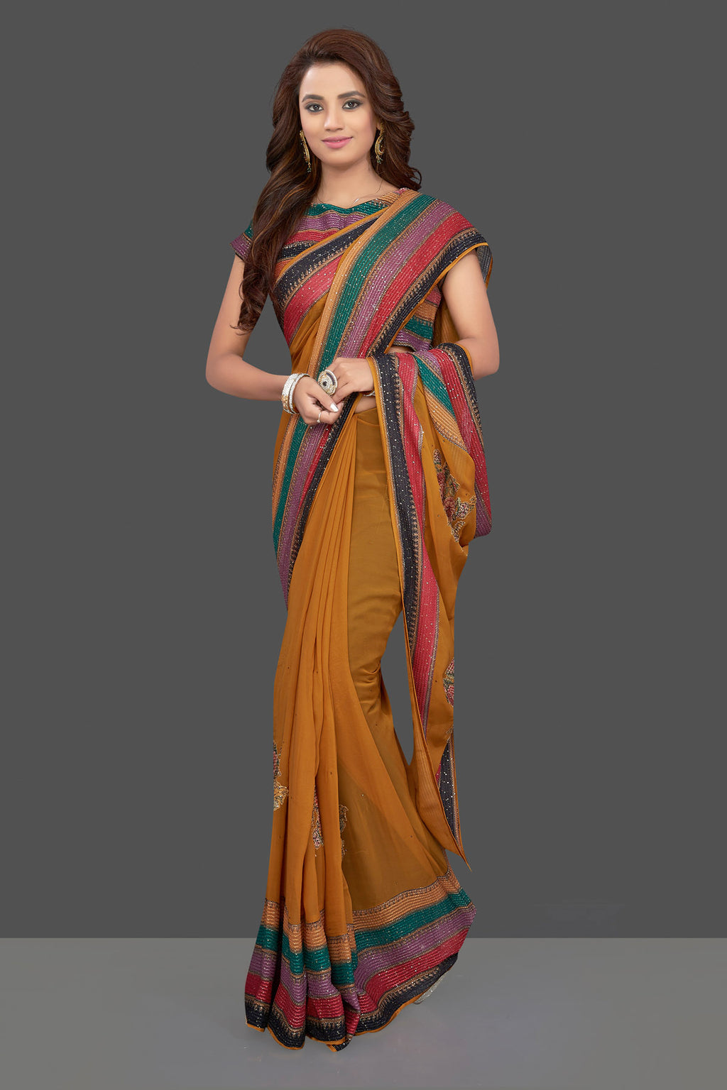 Buy beautiful mustard floral georgette sari online in USA with multicolor saree blouse. Make you presence felt with your Indian style on special occasions in beautiful designer sarees, embroidered sarees, muga sarees, georgette sarees from Pure Elegance Indian fashion store in USA.-full view