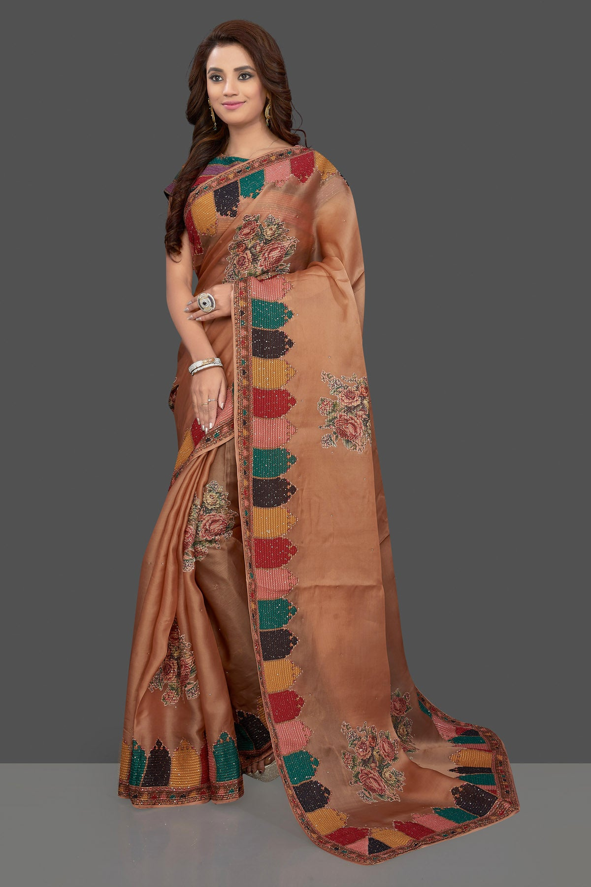 Shop beautiful beige embroidered organza saree online in USA with floral print. Make you presence felt with your Indian style on special occasions in beautiful designer sarees, handwoven sarees, tussar sarees, tussar silk sarees from Pure Elegance Indian fashion store in USA.-full view