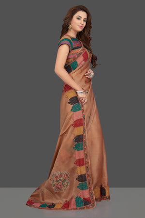 Shop beautiful beige embroidered organza saree online in USA with floral print. Make you presence felt with your Indian style on special occasions in beautiful designer sarees, handwoven sarees, tussar sarees, tussar silk sarees from Pure Elegance Indian fashion store in USA.-side