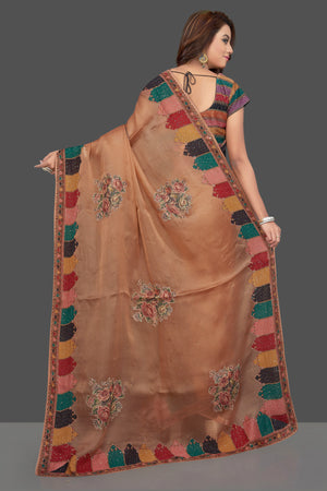 Shop beautiful beige embroidered organza saree online in USA with floral print. Make you presence felt with your Indian style on special occasions in beautiful designer sarees, handwoven sarees, tussar sarees, tussar silk sarees from Pure Elegance Indian fashion store in USA.-backl