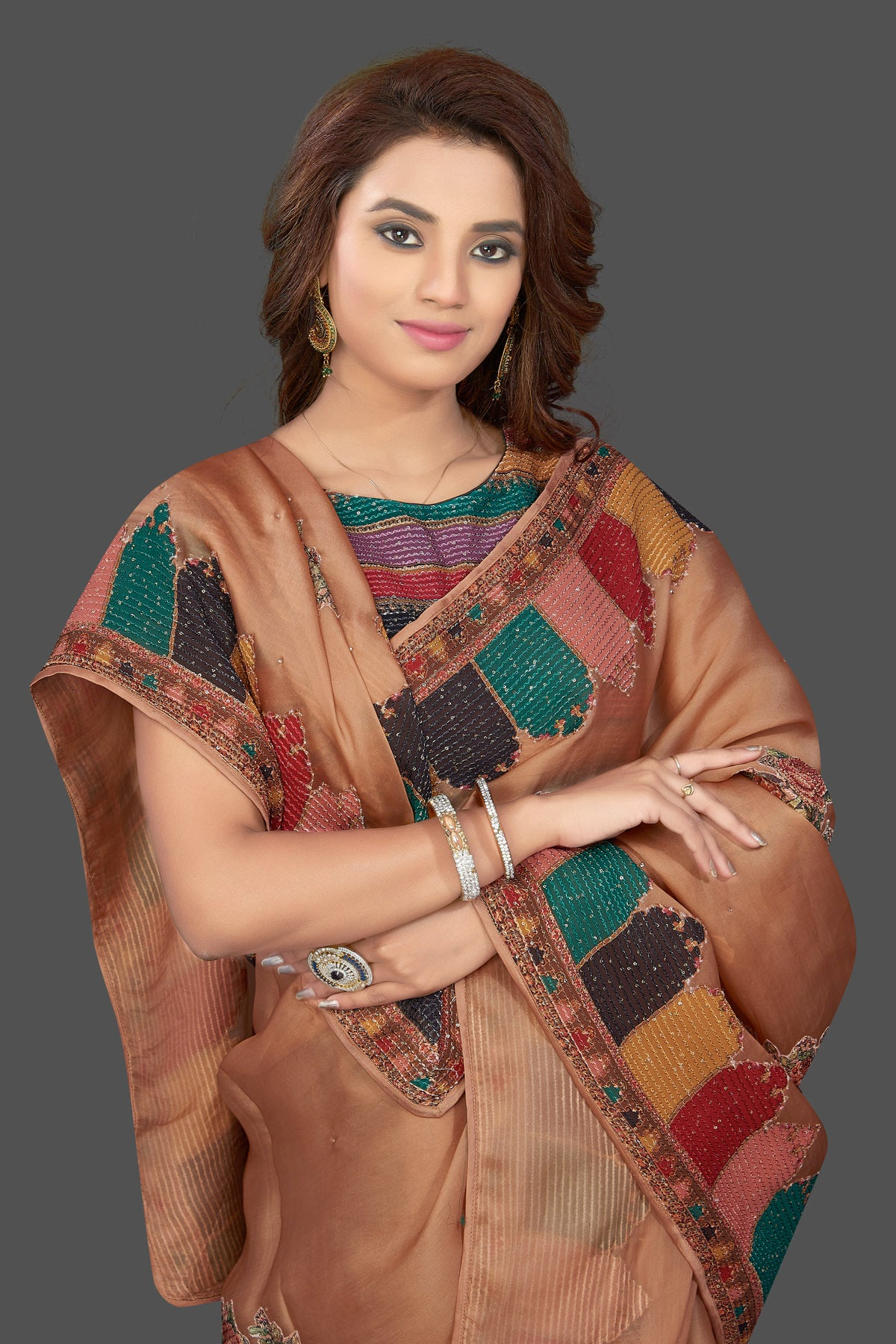Shop beautiful beige embroidered organza saree online in USA with floral print. Make you presence felt with your Indian style on special occasions in beautiful designer sarees, handwoven sarees, tussar sarees, tussar silk sarees from Pure Elegance Indian fashion store in USA.-closeup